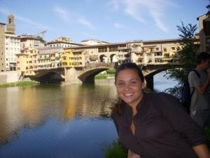 Guerra poses in front of a bridge in Pontevecchio, a region of Firenze, Italy