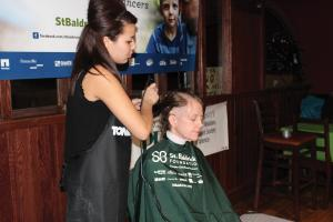 Lauren Taylor: Happi 92.7 host Shari McBride supports the cause and gets her head shaved.