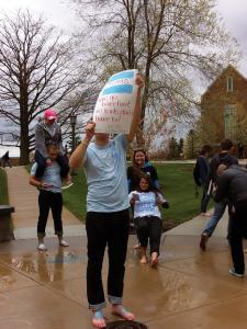 Alicia Cagle photo: TOMS Mercyhurst Campus Club Vice President Garrett Stolz participates in the freeze mob by holding a sign that reads