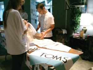 Alex Stacey photo: Students had the opportunity to buy t-shirts and other items to support the TOMS One to One Movement.