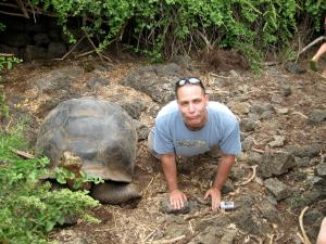 Biology Professor, Dr. Steve Mauro, imitates a giant tortoise in the Galapagos
