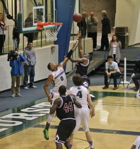 Salina Bowe: Senior James Ewing (0) blocks a shot against IUP during the PSAC semifinals March 3.