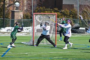 Salina Bowe photo: Jenna Schlagenhauf takes on West Chester goalie, Merrilee Viquers Saturday afternoon. The Lakers won, 12-4.