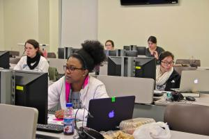 Nhi Tran photo: Students work a shift during the Phonathon Wednesday, April 22. On a single night, there can be 10 to 15 callers and students can pick a shift that fits their schedule.