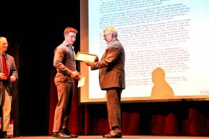 """James Wallace (on left) was presented the third place award by P. Barry McAndrew (on right) for his """"Hemingway Short Story"""" at t: Nhi Tran photo"""