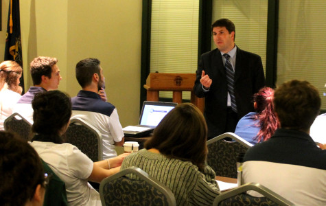 David Dausey, Ph.D., addresses Mercyhurst Student Government about calendar changes.