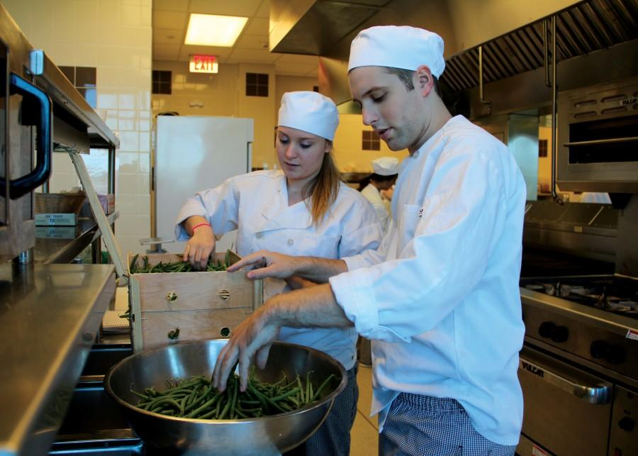 Senior Hospitality Management majors Katy Sieb and Aaron Crecraft develop their culinary skills.