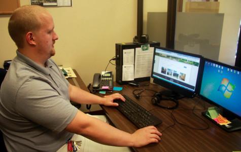 Matt Shallenberger displays Hammermill Library's new website.