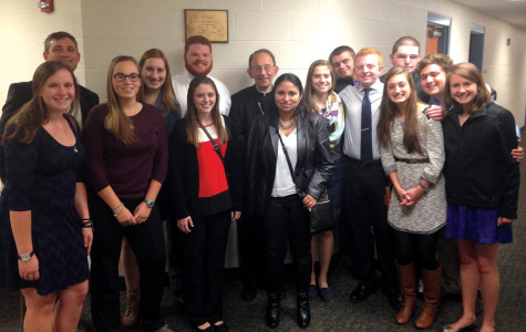 Mercyhurst students and faculty member Greg Baker pose with Bishop Lawrence Persico in Grove City after the annual dinner and discourse event. Students pictured are Rebecca Harms, Michelle Ahrens, Catherine Rainey, Ryan King, Bridget Jacob, Vivian Suazo, Natalie Merucci, Matthew Jury, Tom Matheson, Anna Warner, Michael Best, Sergio Cortes and Mary Jaskowak.