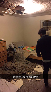 After the ceiling caved in on a third floor Lewis Avenue apartment, the students were relocated to a new residence.