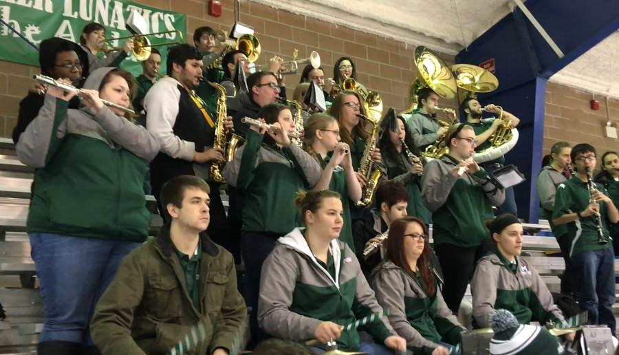 The Mercyhurst University Athletic Band performs at a women's hockey game. The band will be marching at football games in the fall of 2016.