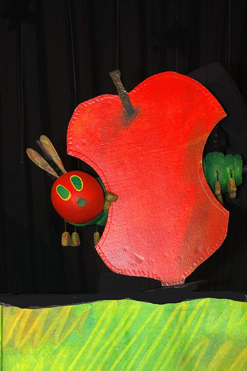 The very hungry caterpillar puppet in action as he eats a variety of foods before he becomes a beautiful butterfly.