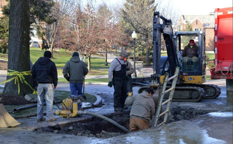 Repair crews work to repair the water main break that occurred on campus this week.