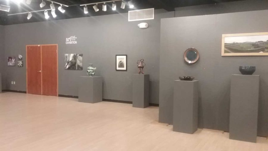 A select few pieces of the artwork by the faculty that is on display in the Cummings Art Gallery.