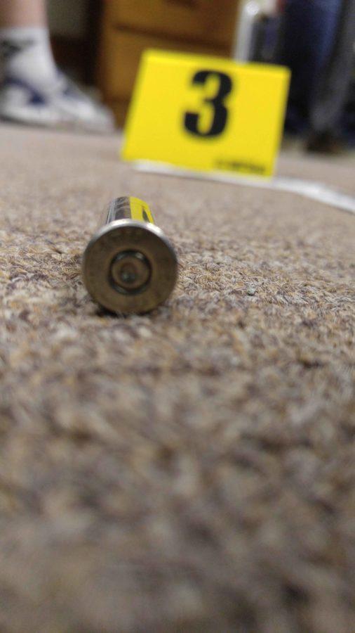 Cartridge casing from Criminalistics photography lab.