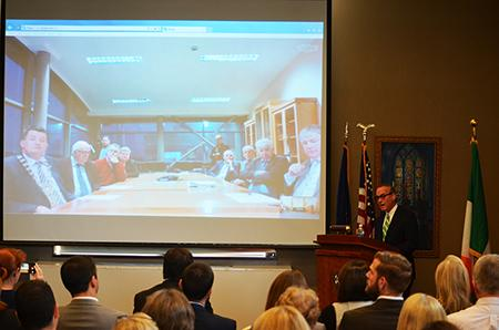 Mercyhurst President Michael T. Victor addresses faculty in Erie and Irish officials about expanding the Mercyhurst campus in Dungarvan, Ireland.
