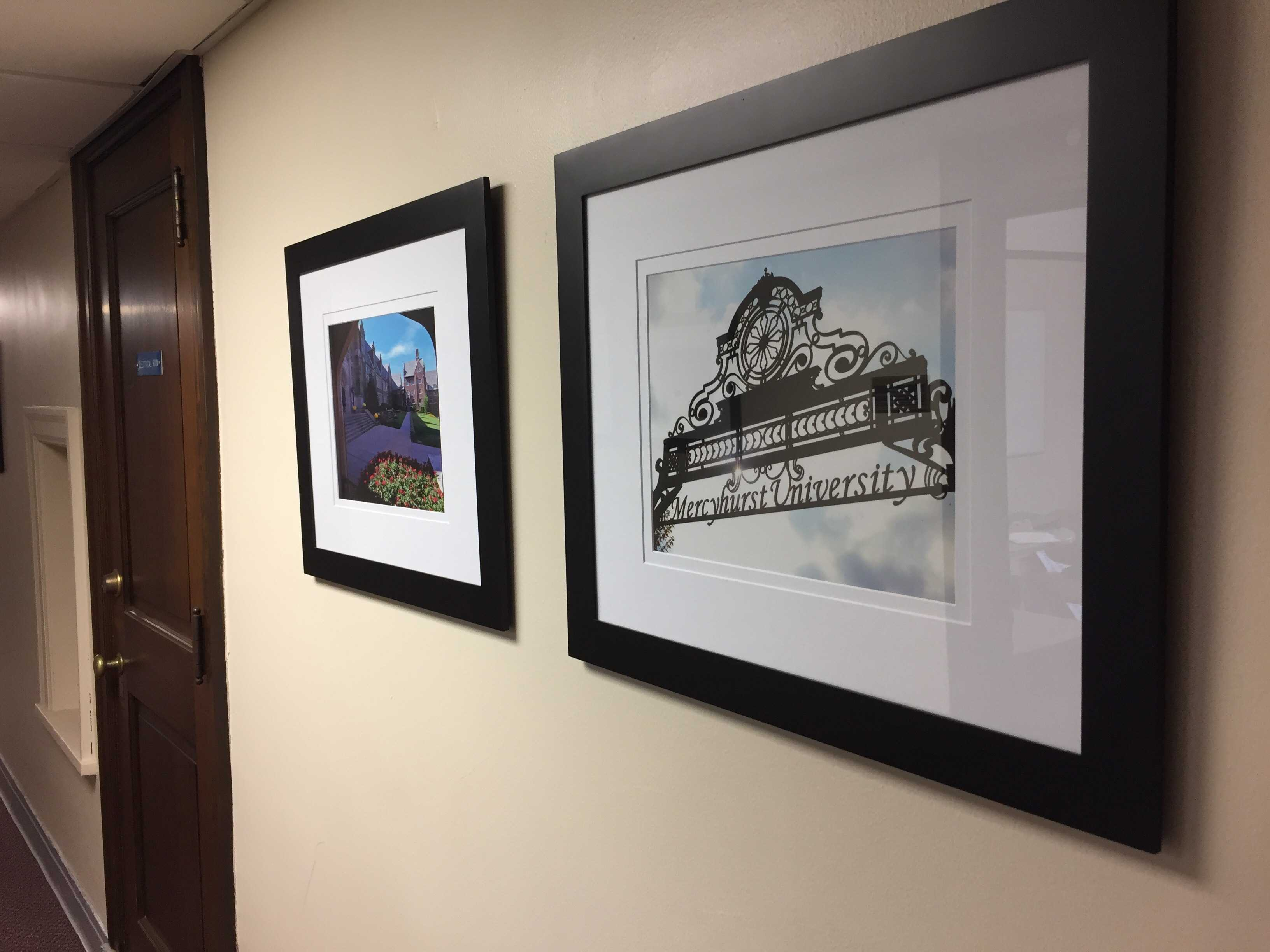 Two of the photos on the second floor of Old Main.