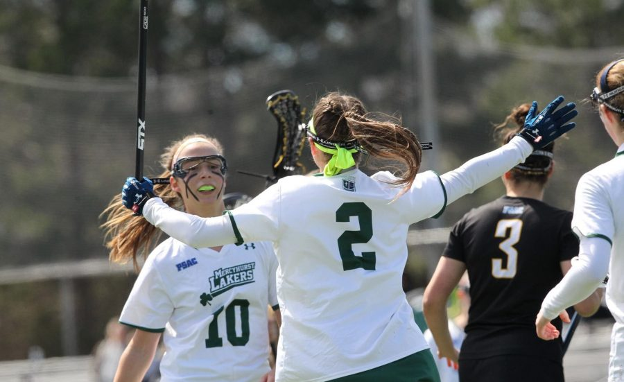Junior+No.+2+Taylor+Izzo+and+Senior+No.+10+Carly+Zimmerman+celebrate+during+Saturday%E2%80%99s+game+against+Bloomsburg+University.++Zimmerman+led+with+six+goals+and+Izzo+three+in+the+13-5+win.