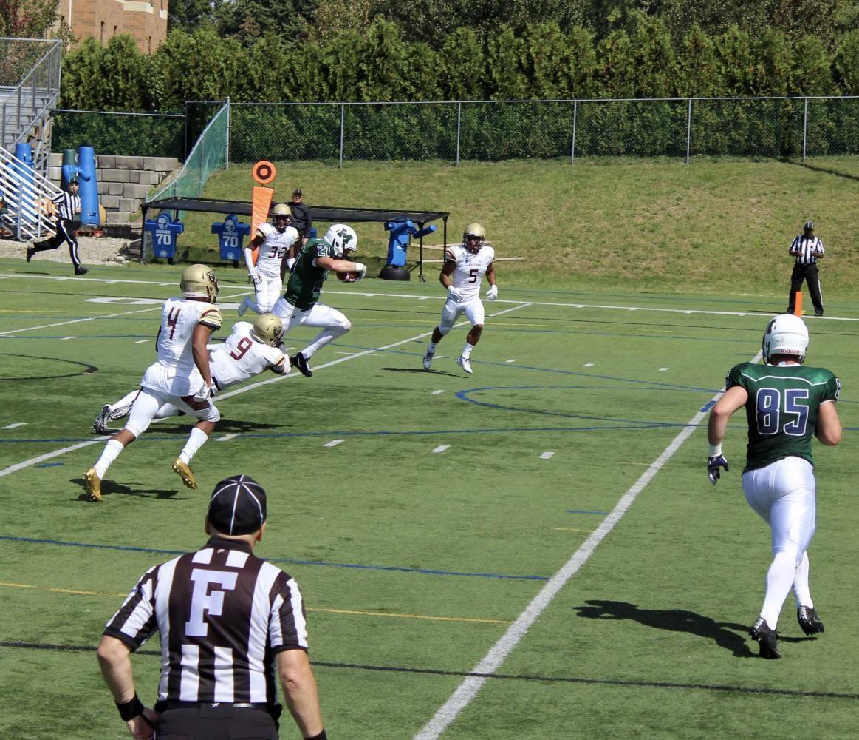 Redshirt Laker freshman running back Garrett Owens moves the chains with a run into Kutztown territory.