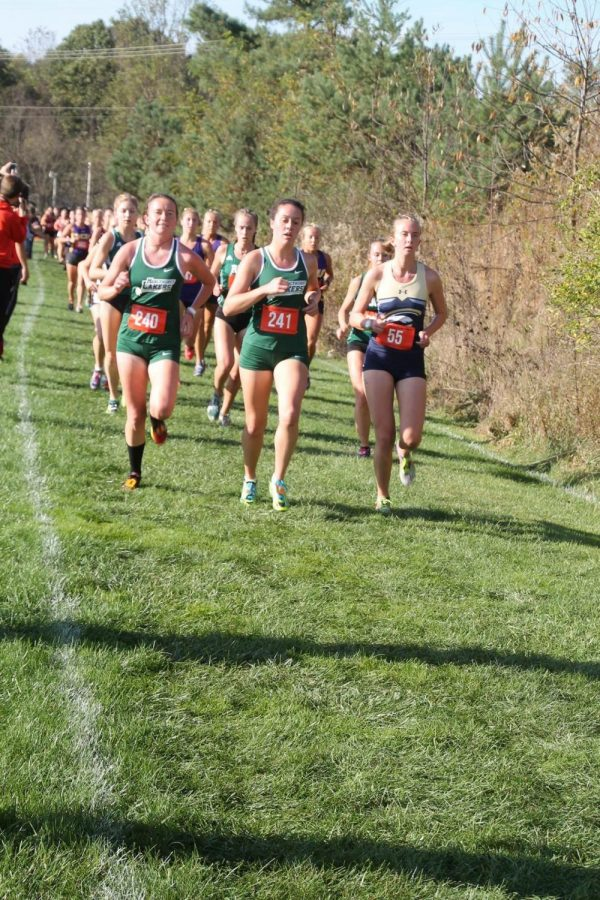 Lakers senior Mary Jaskowak, left, and sophomore Molly Kennedy, right, run at PSAC Championships in California, Pennsylvania.