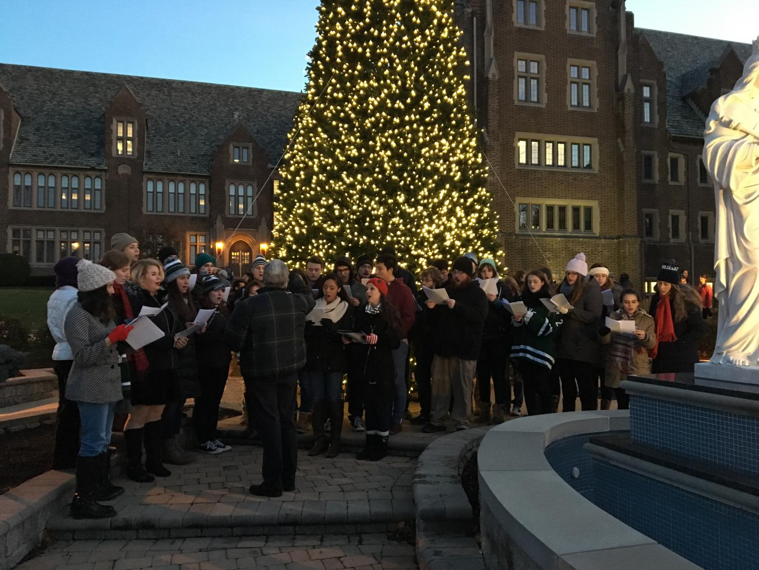 The Concert Choir, under the baton of Thomas Brooks, performs at the tree-lighting ceremony.