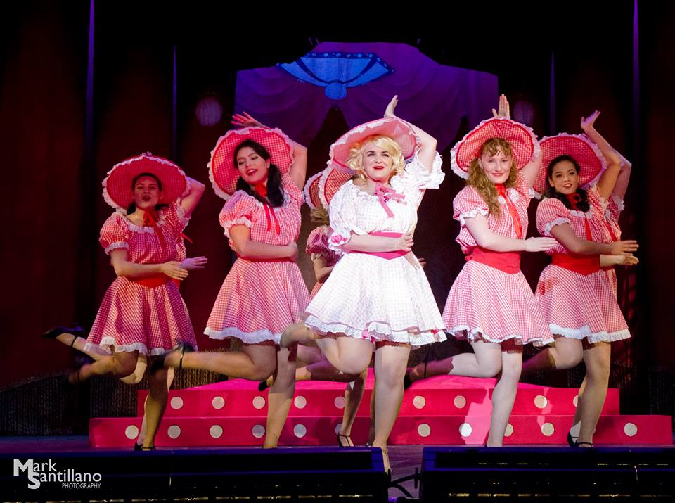 """A few of the """"dolls"""" from """"Guys and Dolls"""" are led by Miss Adelaide, who was portrayed by senior Sarah Krempasky. They were performing a number at the Hot Box, one of the settings in the musical."""