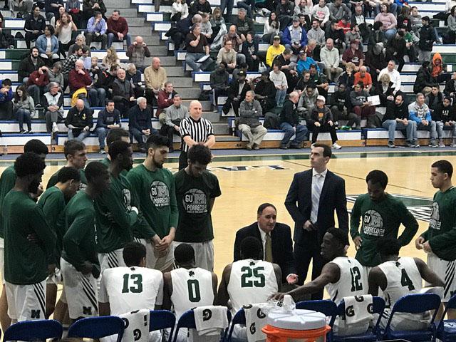The Mercyhurst men's basketball team huddles around coach Gary Manchel during a timeout Feb. 17.
