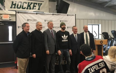 From left are Bill Flanagan and the Rev. Scott Jabo, of Cathedral Prep; Erie Mayor Joseph Schember; Ryan Zapolski, Class of 2011; President Michael T. Victor; and head men's ice hockey coach Rick Gotkin.
