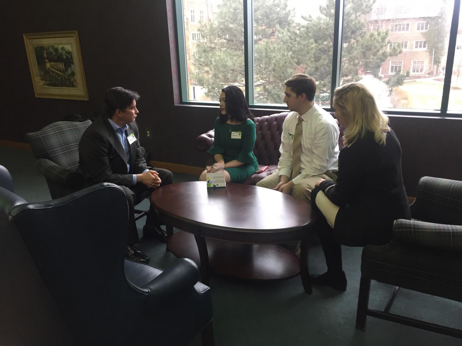 Trustee Lev Kubiak, left, speaks with students, from left, Noelle Zesky, Austin Shinhearl and Hannah Gibson at the Board of Trustees Student Meet and Greet on Feb. 17.