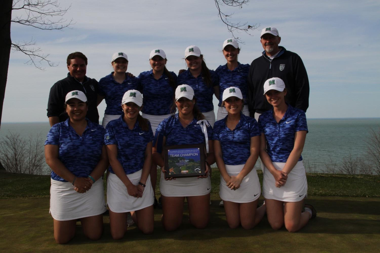 he Mercyhurst women's golf team poses after their tournament victory. The golfers took first place in Mercyhurst's invitational in North East.