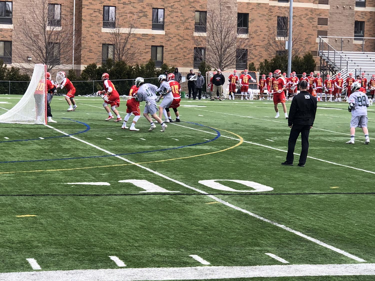 The Lakers' Nathan Grenon, at center, battles in front of the Seton Hill University goal.  Seton Hill would go on to win the matchup 11-9.