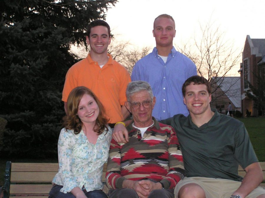 Joe Hepfinger, seated at center, with members the 2005-06 MSG Executive Board.  Seated with him are Jennifer Ciccone, '07, and Dan Schuler, '07. Standing are Ryan Palm, '07, left, and Michael Nichols, '07.
