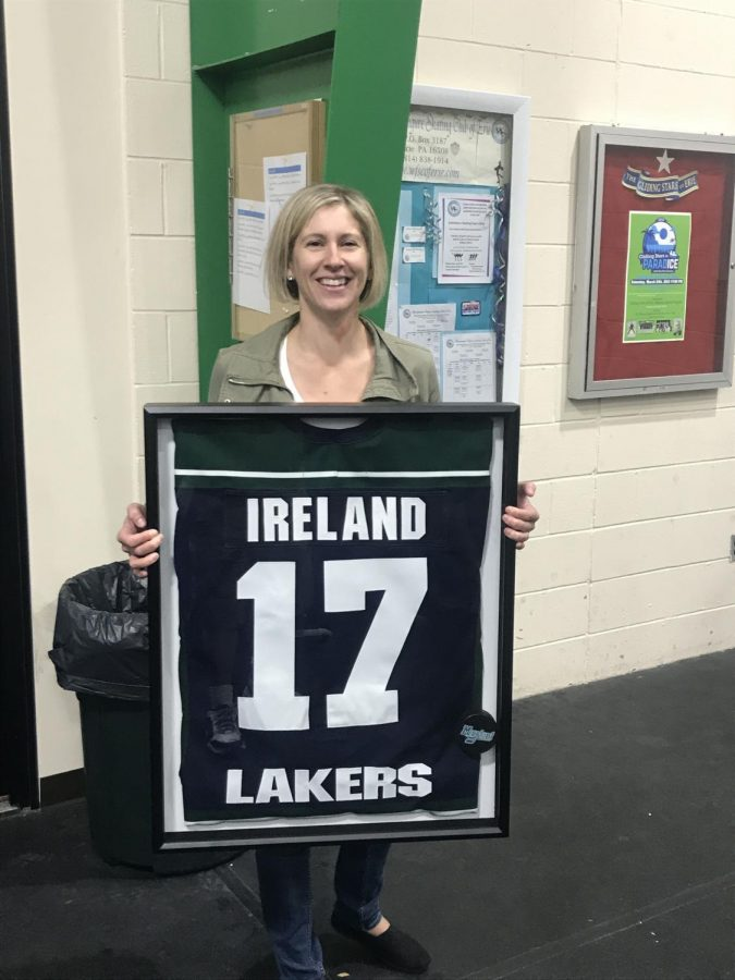 CJ Ireland, '03 alumna and former captain of the women's ice hockey program, poses with her now-retired number.
