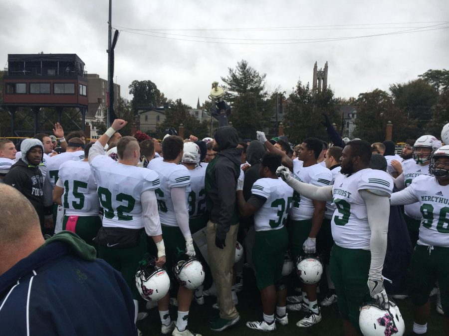 The Lakers hoist the Niagara cup victoriously after their 38-21 victory over the Gannon University on Oct. 27.  The victory marks the third year in a row that the Lakers football squad has beaten Erie rival Gannon.