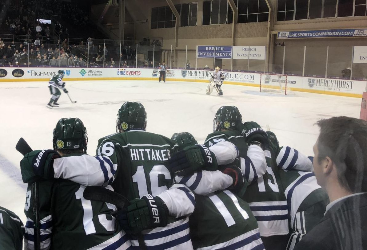 No. 13 Josh Lammon, No. 16 Matthew Whittaker and No. 15 Tommaso Bucci look on during the shootout at the end of the Mercyhurst-Notre Dame game.  The game officially ended in a 6-6 tie.