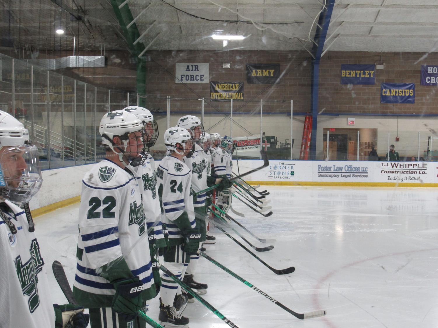 he Lakers line up at their end of the ice before the start of the game against Army West Point.