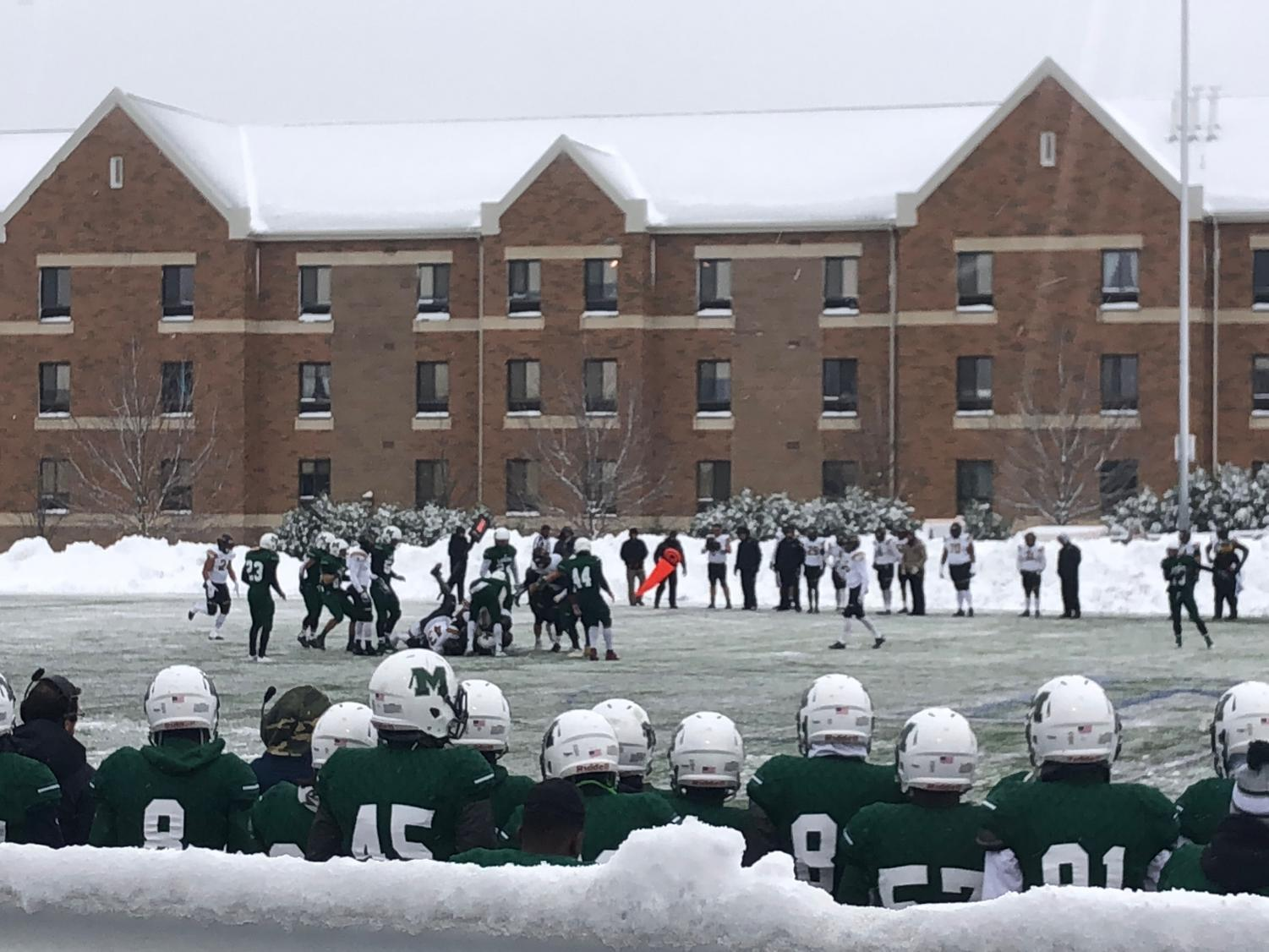 Tullio Field had to be shoveled before the start of the contest Nov. 10.  Snow blanketed everything from the stands to the green itself, which had to be tended throughout the game to keep lines visible.