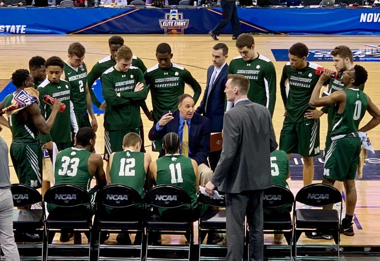 Seated from right, Mercyhurst's Patrick Smith, Nicholas Lang, Nelson Maxwell, and Trystan Pratapas listen to Head Coach Gary Manchel during the Elite 8 game against Northwest Missouri State.