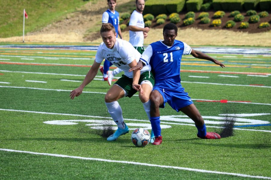 The Lakers' Henri Tophoven battles Urbana Unversity's Cory Carr for control of the ball during Thursday's home opener.  Currently, the Lakers are 1-0-1 after tying Urbana and besting Ohio Dominican University.