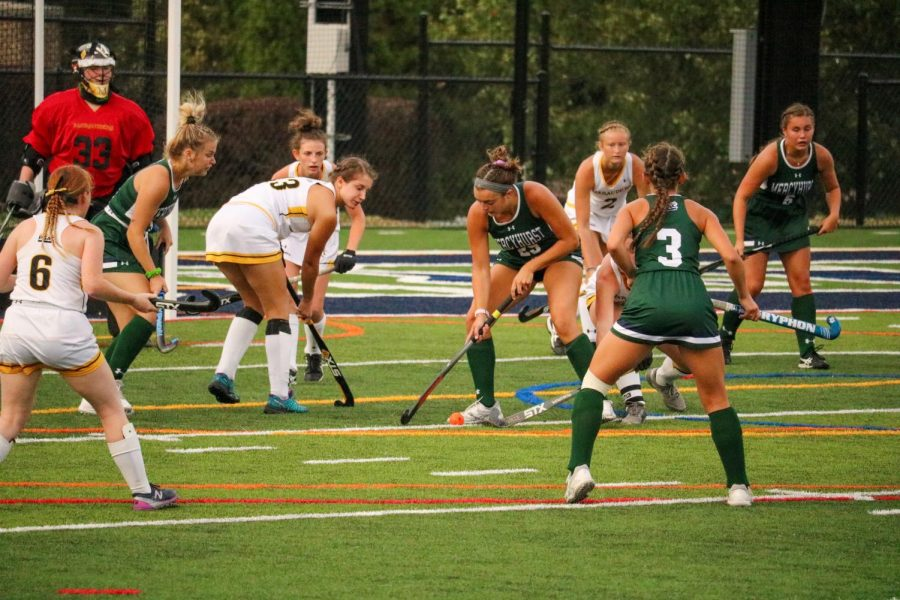 Clare Ahern, right, swipes the ball away from players from Millersville University. Teammate Mia D'Amato (No. 3) watches in the foreground.