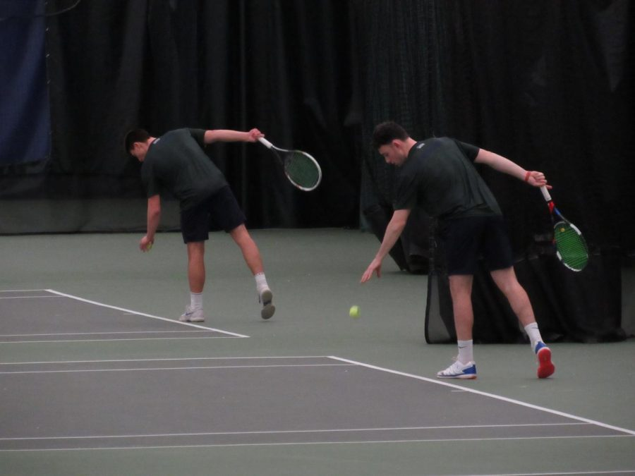 Mercyhurst men's tennis players junior Unai Amilleta (left) and senior Cormac McCooey (right) get ready to serve the ball during their Saturday match versus Saint Francis University.