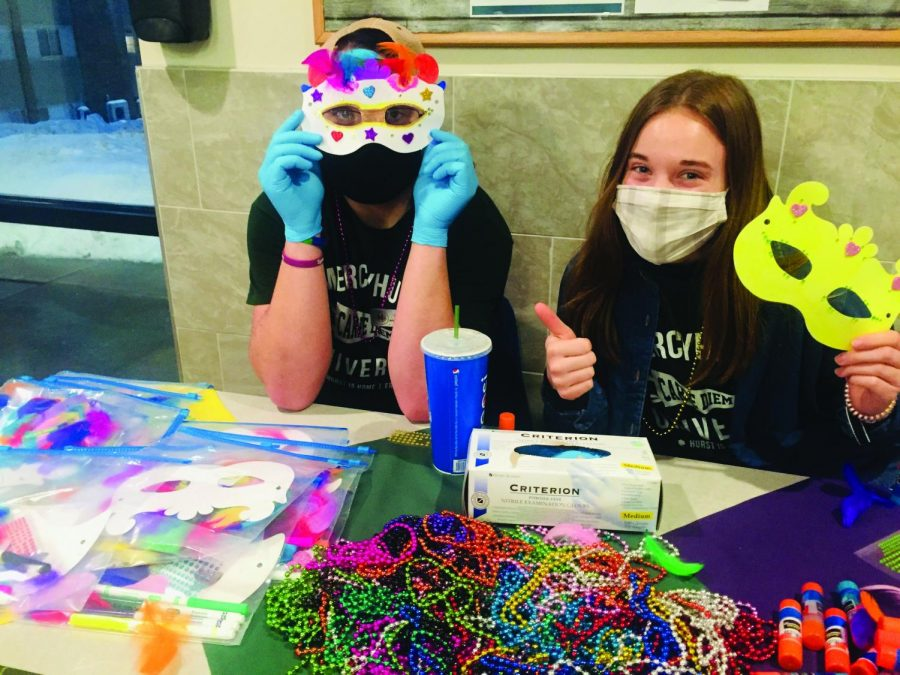 (Left to right) Chris Streibech, Ethan Nannen, Adam Schlereth and Riley Heeden create Carnaval masks while at the Grotto Commons.