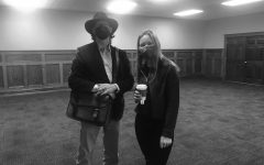 Dr. Gregory Brown and student Megan Siegfried conversing over tea and snacks at the Victorian Tea event on April 21 at the Mercy Heritage Room.